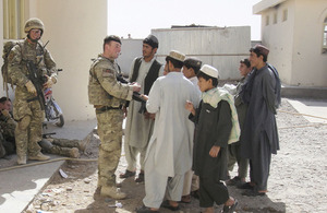 Lance Corporal David Murphy chats to students at the Aru Dalam School in Lashkar Gah