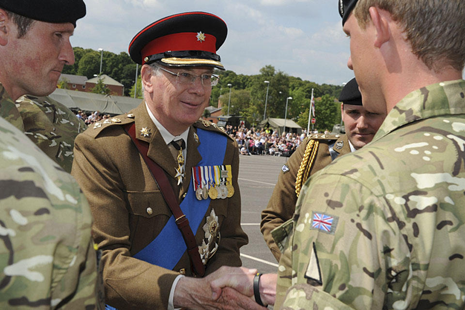 His Royal Highness The Duke of Gloucester presents soldiers of the 2nd Royal Tank Regiment with Op HERRICK campaign medals