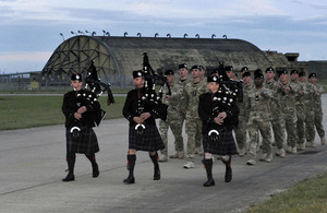 Soldiers of the 1st Royal Tank Regiment march into their base at RAF Honington led by Army pipers