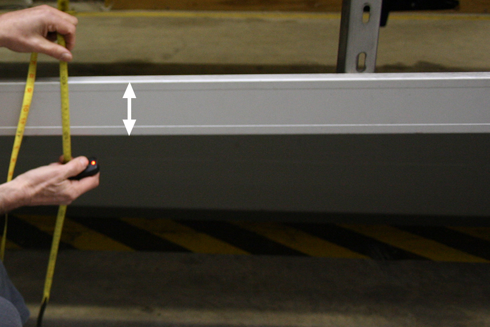 DVSA measure the height of the rail.