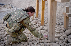 Para Musician Kate Whittaker visits the Cross and Memorial Stone at Camp Bastion in tribute to her brother, Joe, killed in Helmand in 2008