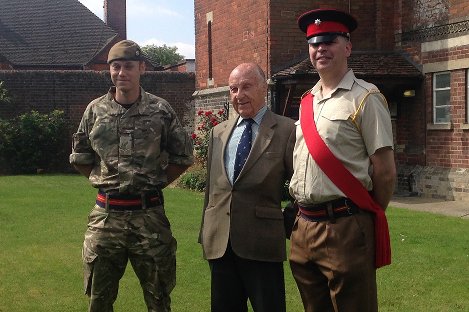 Lance Corporal Lewis Treloar MBE, Mr Riggs and Colour Sergeant Naylor at Royal Anglian Headquarters