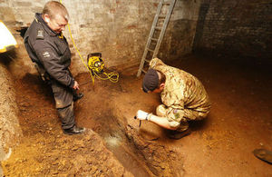 Military EOD experts examine an unexploded World War Two bomb in Bethnal Green