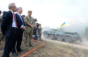 Defence Secretary Michael Fallon observes Ukrainian soldiers demonstrating skills learned from UK training teams