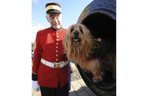 Newly-promoted Blue inside Mons Meg, the famous cannon at Edinburgh Castle, with his handler Brian McKenzie, Chairman of the One O'Clock Gun and Time Ball Association