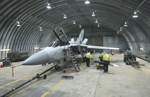 A missile being loaded onto a Tornado F3 for a flight trial