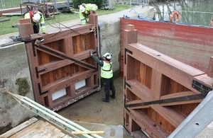 Grafton Lock in Oxfordshire. Environment Agency staff are checking the positioning of the new gates.