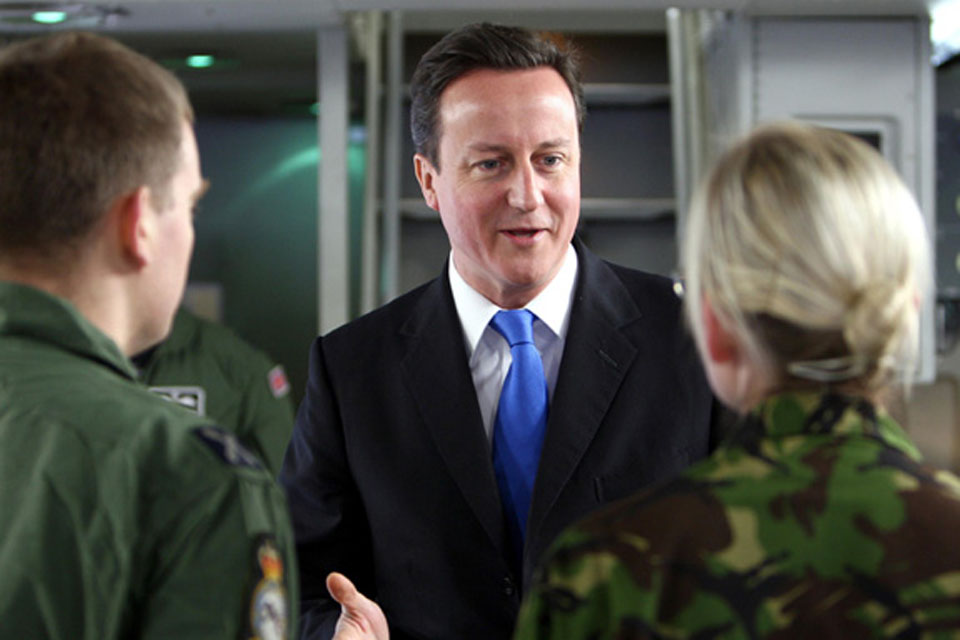 Prime Minister David Cameron talking to RAF personnel on the flight deck of the RAF's newest C-17 transport aircraft
