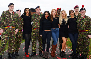 The Saturdays pose with servicemen at the launch of the 2010 Royal British Legion Poppy Appeal at Colchester Garrison, Essex