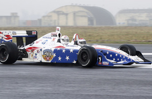 A lucky member of the personnel serving at RAF Honington is taken for a spin by Mario Andretti
