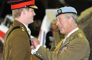 Lieutenant Wales is given his flying wings by his father The Prince of Wales