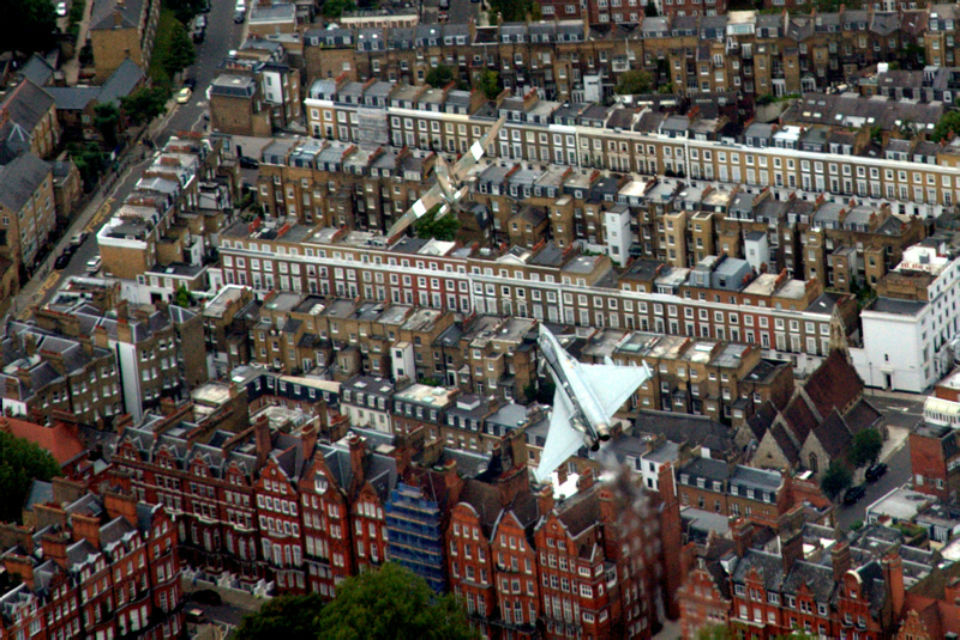 Air-to-Air image of a Hurricane and Typhoon aircraft flying over London for VJ Day 70th.