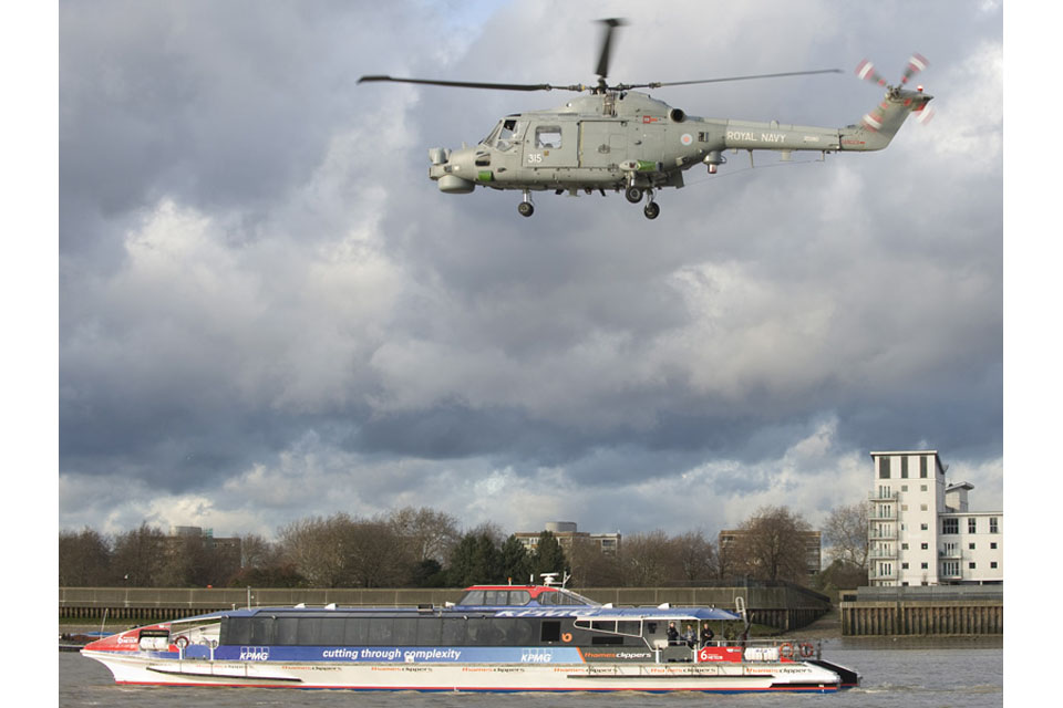 A Royal Navy Lynx helicopter hovers over a 'suspect ferry'