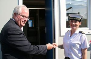 DIO Director Service Delivery Leo O'Shea welcomes AB Leanne Roberts to her new accommodation at HMS Caledonia [MOD Crown Copyright]