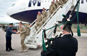 Group Captain Ian Gale greets members of 617 Squadron on their return to RAF Lossiemouth