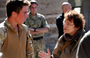 Permanent Secretary Ursula Brennan talks to Private Stuart Chamberlayne, from D Company, 3rd Battalion The Parachute Regiment, about his experiences in Helmand province