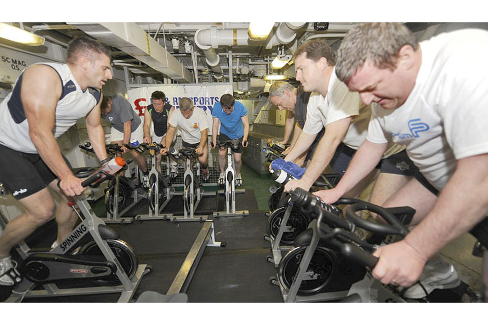Members of HMS Ark Royal's ship's company improving their physical fitness using the newly-procured 'spinning' bikes