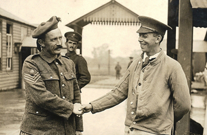 Fred Potts shaking hands with his Enniskillin Fusilier rescuer.