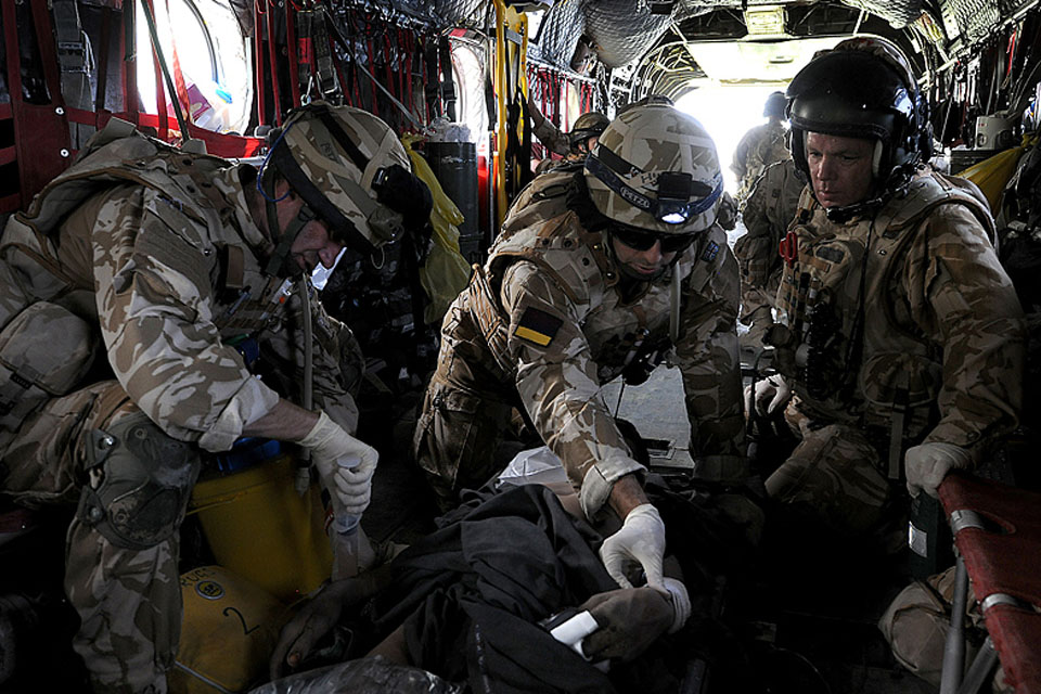 Members of a Medical Emergency Response Team treat a casualty in the back of a Chinook helicopter during transit to Camp Bastion field hospital (stock image)