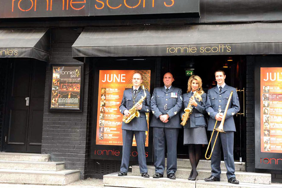 Stacey Solomon with some of the RAF Squadronaires outside Ronnie Scott's club in London