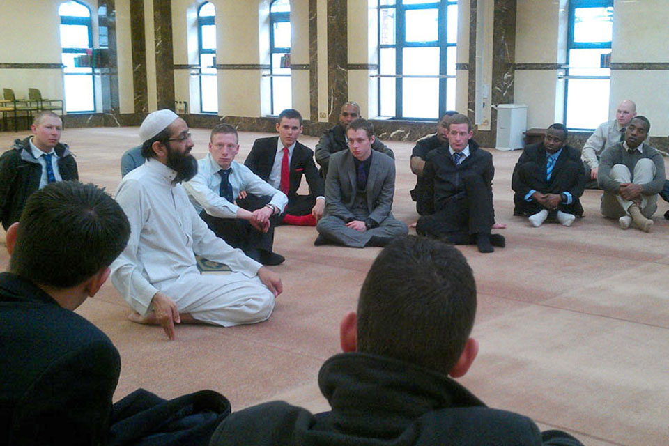 Imam Molana Rashid meets with soldiers from 1st Battalion The Royal Welsh at the Zakaria Mosque in Bolton