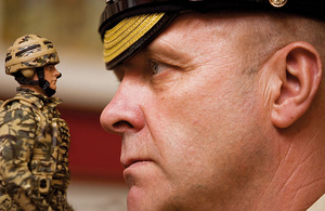 Garrison Sergeant Major Bill Mott with one of the HM Armed Forces infantryman action figures to which he has lent his voice