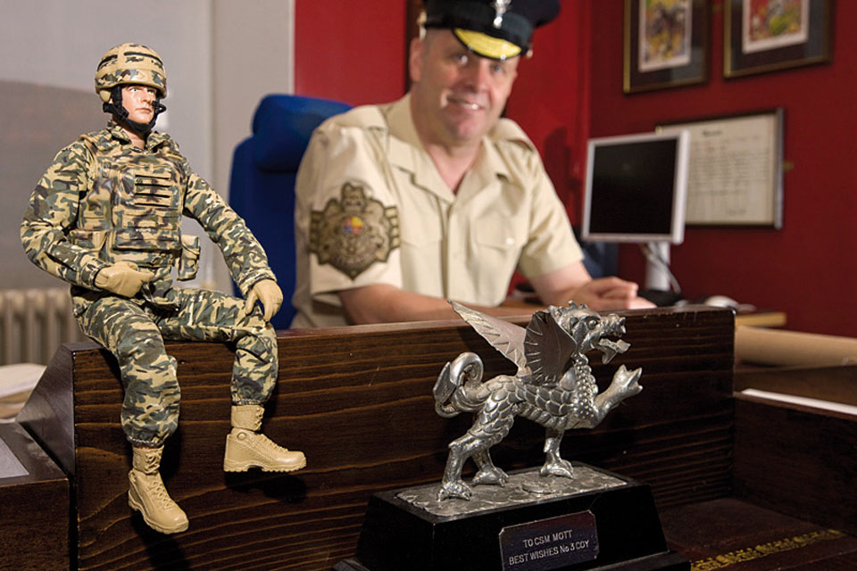 Garrison Sergeant Major Bill Mott shares his London District office in Horse Guards with an HM Armed Forces infantryman action figure