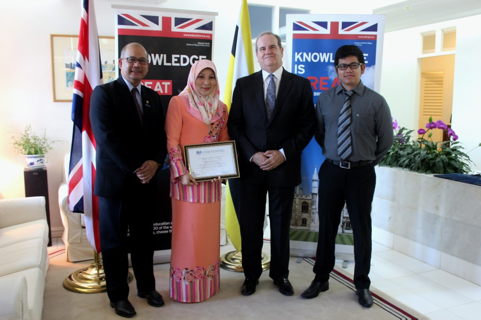 British High Commissioner David Campbell with Senior Superintendent Dinah, her husband Haji Abdul Rahim Derus who was also a Chevening scholar, and their son