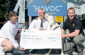 Personnel at HMS Raleigh with the cheque for the Nowzad Dogs charity