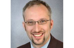 Dr Christian K Schneider