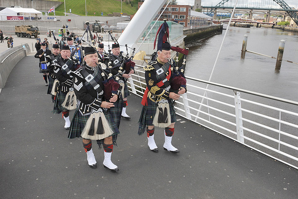 A Band of Pipers leading the way at the start of the march in Gateshead
