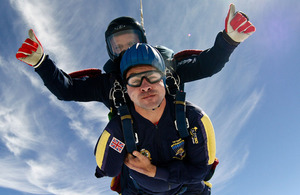 Corporal Andy Reid in a tandem skydive at the Army Parachute Association drop zone at Netheravon in Wiltshire