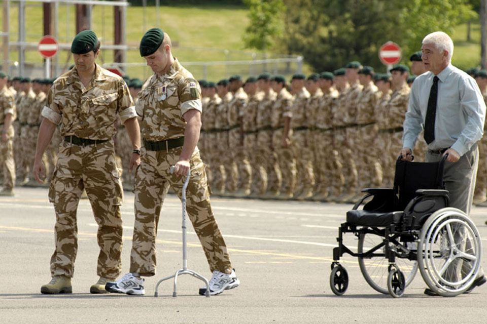 Marine Mark Ormrod, 40 Commando Royal Marines (second from left), receives his campaign medal following a six-month tour in Afghanistan's Helmand province on Operation HERRICK 7