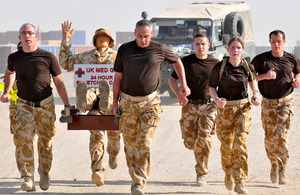 Medics taking part in the stretcher-carry around Camp Bastion to raise money for Service charities