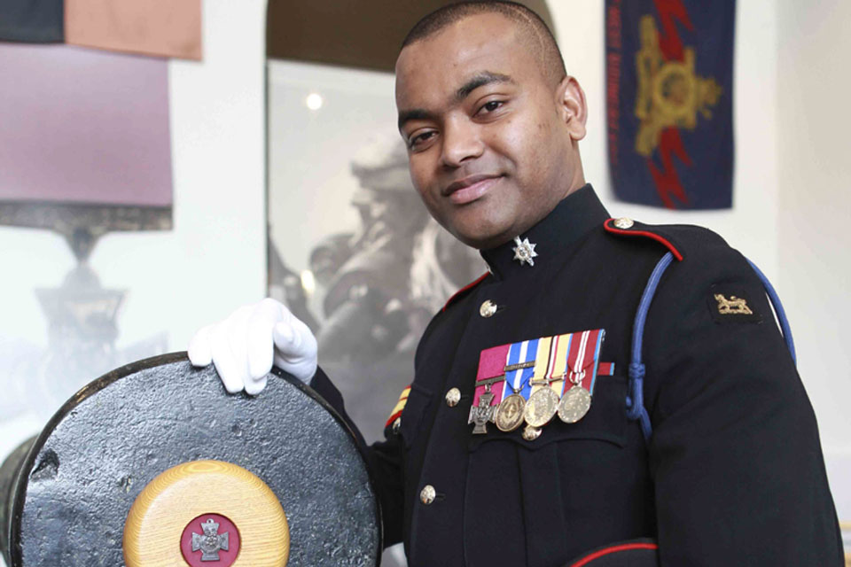 Corporal Johnson Beharry with one of the guns from which the Victoria Cross is struck