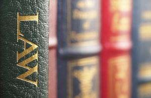 Some law books on a shelf.