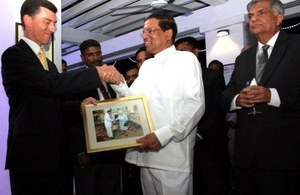 High Commissioner handing over Sri Lankan President a photograph of Her Majesty Queen Elizabeth the Second meeting Sri Lankan President.