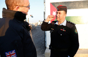 Former British police officer Stephen Boddy speaks with Lieutenant Ahmad Mjalli of the Jordanian Community Police team in the Za'atari refugee camp. Photo: DFID / Russell Watkins