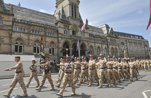 Soldiers from 11 Light Brigade march through the streets of Winchester
