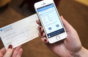 Mobile phone using a cheque imaging application to photograph a cheque