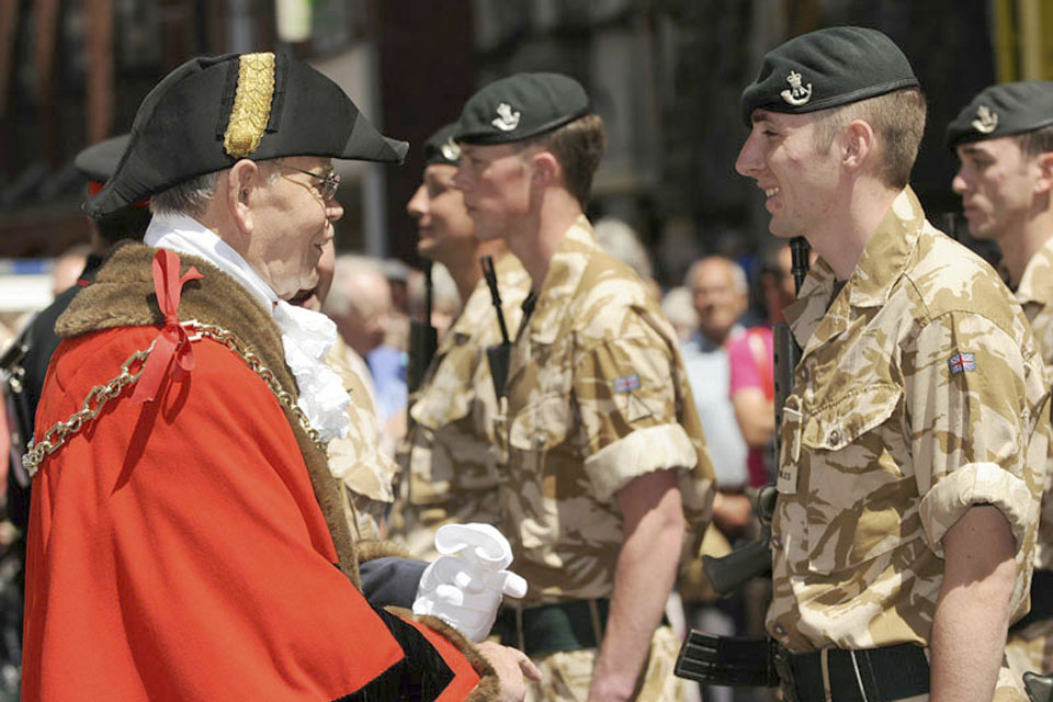 Les Phillips, the Mayor of Dorchester, meets a soldier from 4 RIFLES