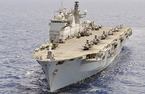 HMS Ocean with helicopters on deck including the USAF HH-60, Lynx Mk7, Sea Kings from 857 Naval Air Squadron, and Apaches from 656 Squadron Army Air Corps