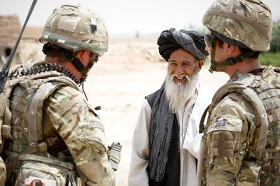 51 Squadron RAF Regiment personnel with a village elder