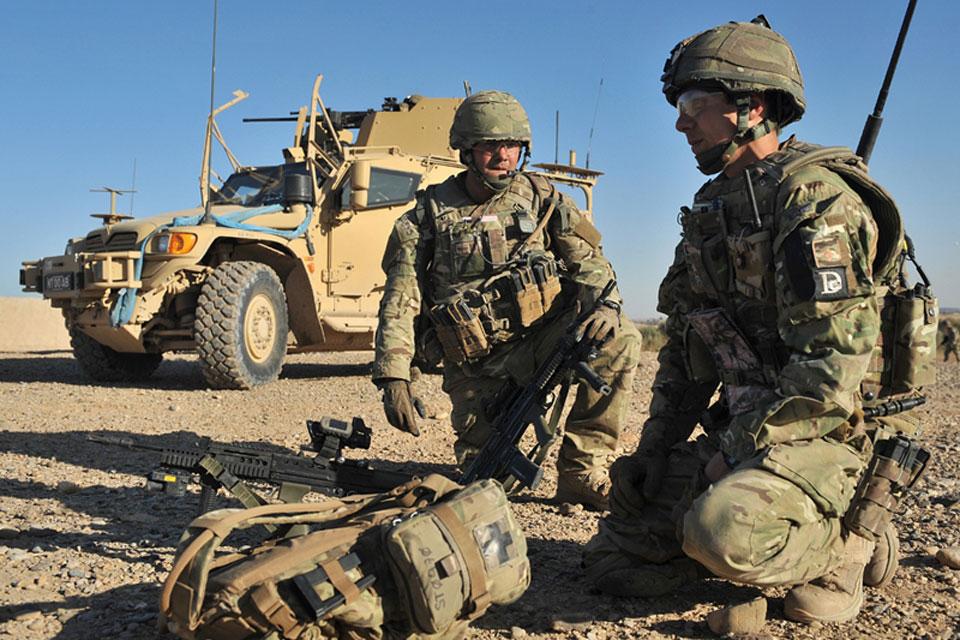A reservist alongside a Regular Army colleague