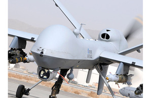 RAF Reaper Remotely Piloted Air System taxis along the runway at Kandahar Air Field, Afghanistan