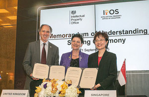 Image of Scott Wightman, Baroness Neville Rolf and IPOS with the signed agreement.
