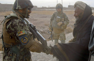 Members of 15 Squadron RAF Regiment and the Afghan Air Force on patrol in the village of Koshab