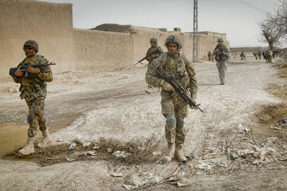 Members of 15 Squadron RAF Regiment and the Afghan Air Force patrol through the village of Koshab