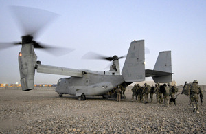 Members of II Squadron RAF Regiment and the US Marine Corps board a US Osprey aircraft at Camp Bastion in Helmand province