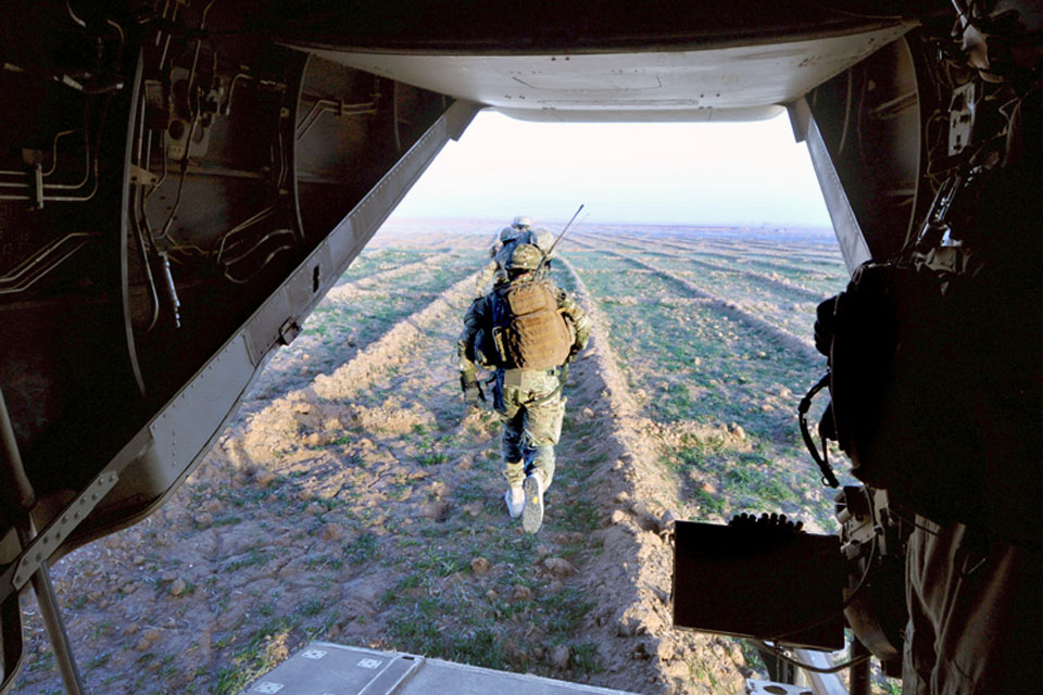 Members of II Squadron RAF Regiment and the US Marine Corps exit a US Osprey aircraft during Operation DISHATA PASHA